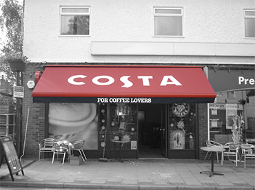 red and black costa coffee awning